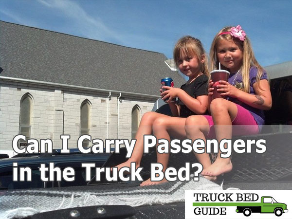 passengers on truck bed